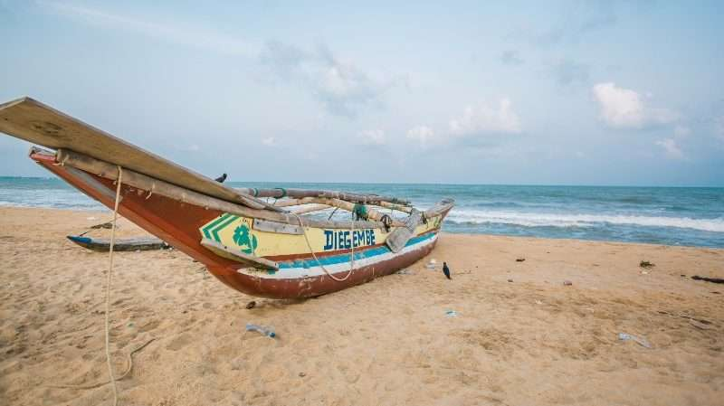 negombo beach and traditional boat